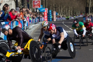 LONDON, UK - APRIL 21, 2013: Wheelchair competitors at the Virgin London Marathon April 21st 2013 in London. Pictured in the leader pack at 26 miles (l to r): Marcel Hug (2nd), Kurt Fearnley (winner), David Weir, Ernst Van Dyk (3rd), Tomasz Hamerlak.